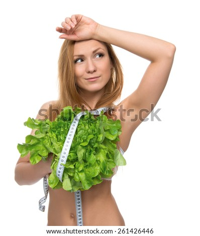 Dieting concept Beautiful Young Woman on diet with healthy food salad and tape measure meter isolated on a white background - stock photo
