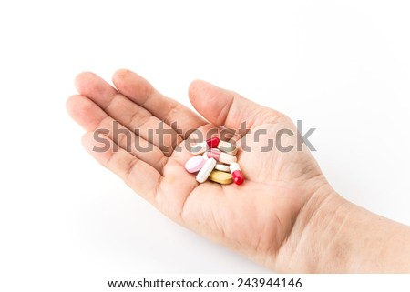 diferent Tablets pills capsule heap mix therapy drugs doctor flu antibiotic pharmacy medicine medical on hand - stock photo