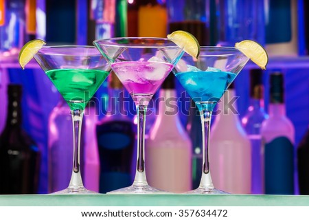 Different alcohol color drinks with lime - stock photo