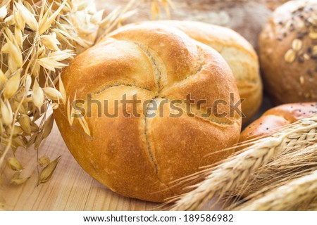 Different bakery products among the ears of cereals