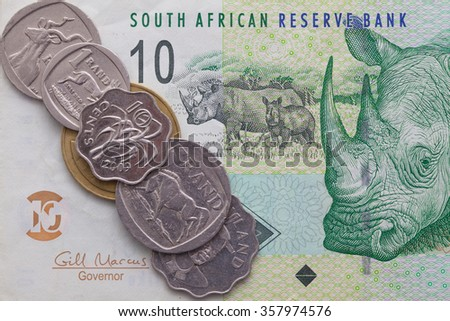 Different banknote and coins of  Rand of South Africa - stock photo