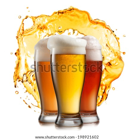 Different beer in glasses with splash isolated on white background - stock photo