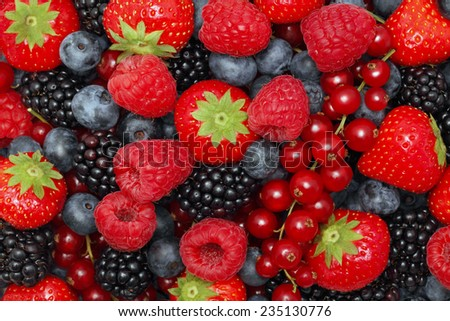 Different berries (blueberry, raspberry, strawberry, red currant, blackberry). Background - stock photo