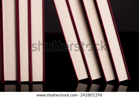 Different books against a black surface - stock photo