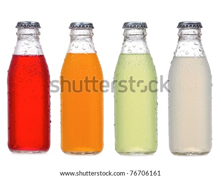 different bottles of soda on white background