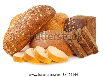 Different bread arranged on table close up - stock photo