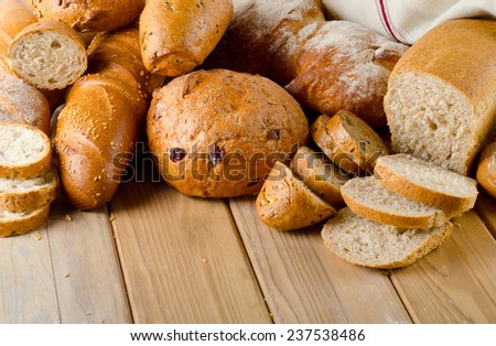 Different bread on a wooden background. Selective focus - stock photo