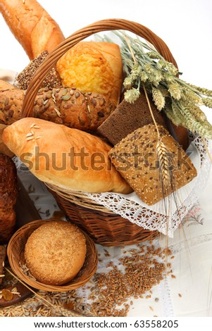 Different bread products in a basket - stock photo