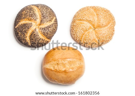 Different bread rolls, natural, covered with sesame and with poppy seeds, typical German breakfast food. Studio shot, cutout, isolated on white background. - stock photo