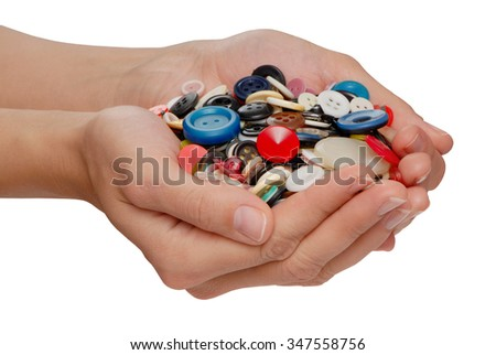 different buttons in female hands - stock photo