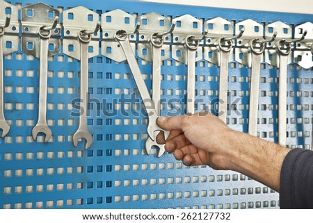 Different Car repair wrench tools set on the wall - stock photo