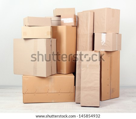 Different cardboard boxes in room - stock photo