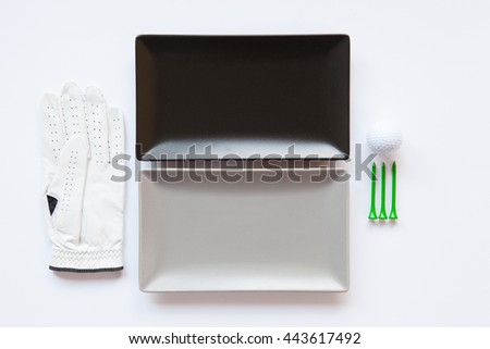 Different  ceramic dishes with golf glove on over white background, rectangle dish - stock photo