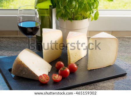 different cheese of South of France with tomatoes and wine
