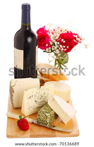 Different cheese with wine and roses isolated on white background - stock photo