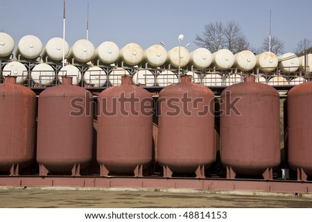 different cisterns standing under blue sky - stock photo