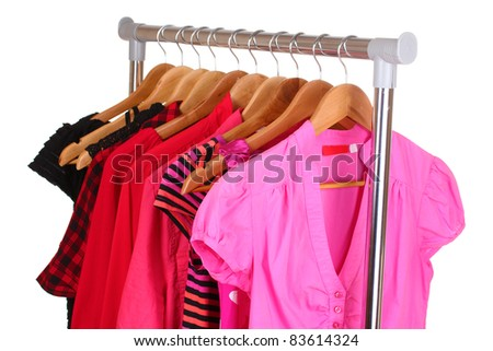 different clothes on hangers isolated on white - stock photo