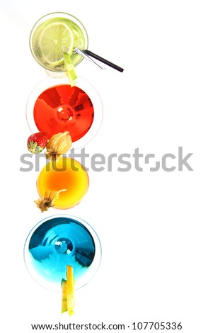 Different cocktails or longdrinks garnished with fruits on white background - stock photo
