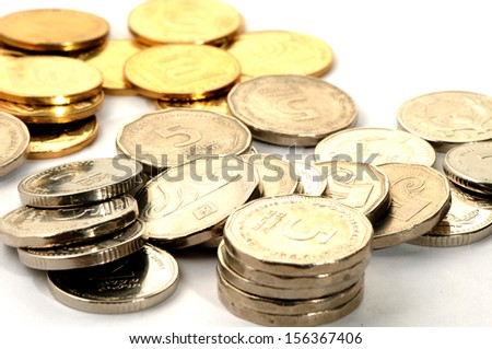 Different coins on white background - stock photo