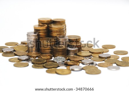 Different coins stacked on white background