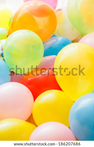 Different color balloons in a bright light - stock photo