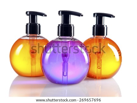 different color cosmetic bottles - stock photo