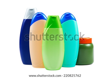 Different color tubes and bottles for hygiene, health and beauty on a white background. - stock photo