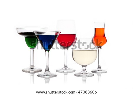 different colored drinks in wineglasses - stock photo
