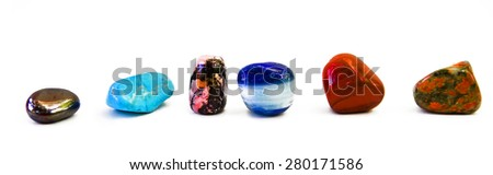 different colored stones in row isolated on white - stock photo