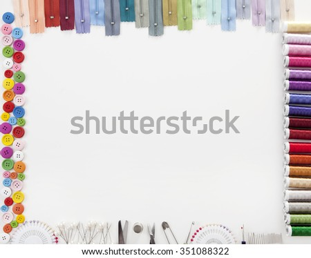 Different colorful accessories to tailor with white space for text in the middle - stock photo