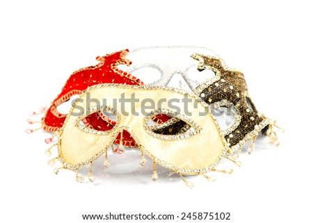 Different colorful carnival masks over white background - stock photo