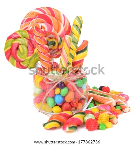 Different colorful fruit candy in jar isolated on white - stock photo