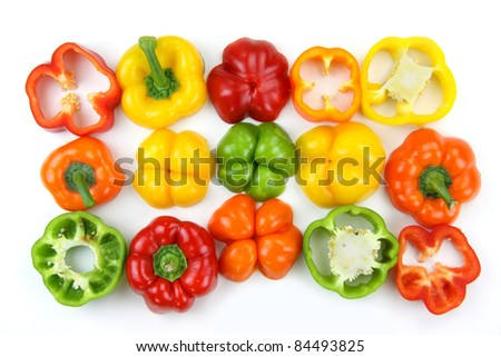Different colorful pepper slices on white background - stock photo
