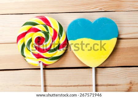 Different colorful sweets and lollipops on the wooden table. - stock photo