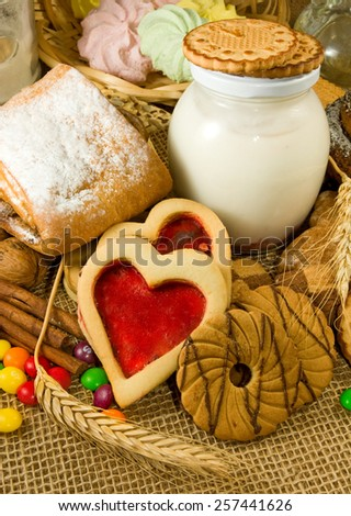 different cookies with yogurt and bank - stock photo