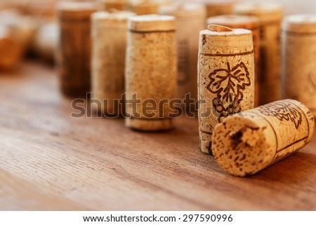 Different corks on wooden surface - stock photo