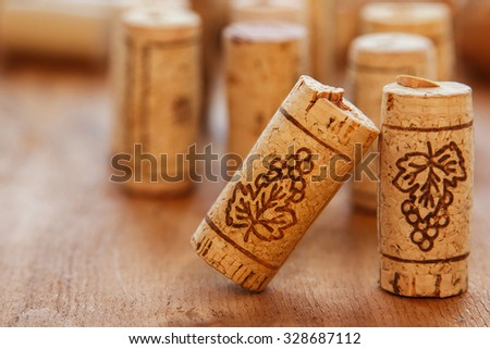 Different corks on wooden surface