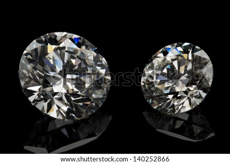 Different cuts of diamond isolated on black background.
