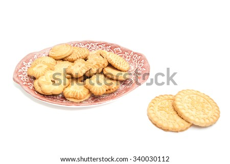 different delicious cookies on a plate on white