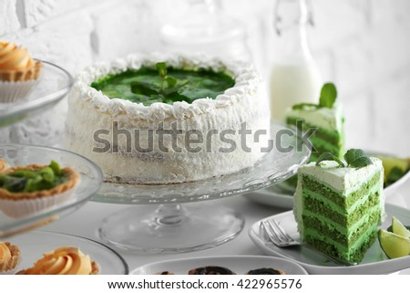 Different delicious desserts on table - stock photo