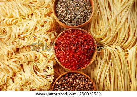 Different dry instant noodles with spices close-up - stock photo