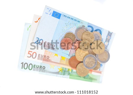 Different euro banknotes and coins isolated in white background - stock photo