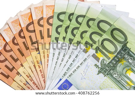 Different euro banknotes in a stack on the table.. - stock photo