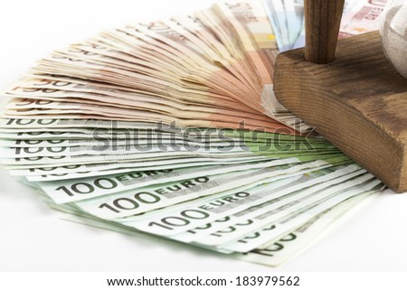 Different euro banknotes with hourglass - stock photo