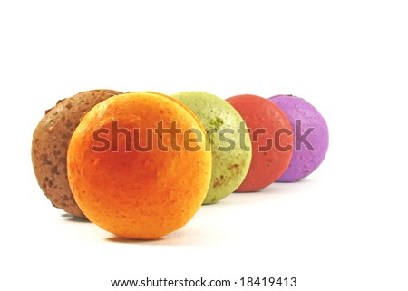 different flavored macaroons on display - stock photo