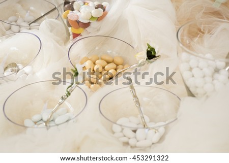 different flavors of sugared almonds on their wedding day - stock photo