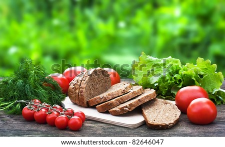 Different food ingredients on the old table - stock photo