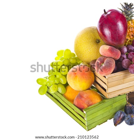 different fresh fruit in colorful wooden boxes  isolated on white background