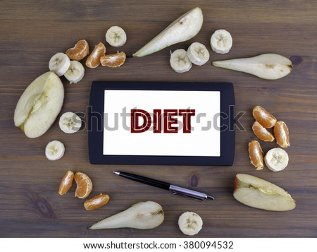 Different fruits around tablet with text Diet - stock photo