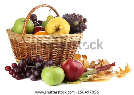Different fruits with basket and yellow leaves isolated on white